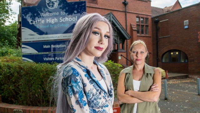 """Lewis Bailey, 14, who was banned from a school talent show as he was going to perform a drag act, Dudley, West Midlands - Pictured with mum Natalie Bailey. See SWNS story SWDRAG. A 14-year-old boy claims was banned from his school talent show - over his DRAG ACT. Lewis Bailey had been practising his lip-sync dance routine in his heels for weeks so was distraught when teachers said he couldn't take part. His furious mum Natalie, 37, claims the school's legal team said it was illegal for under 18s to take part in drag act competitions. But brave Lewis and his proud family have accused the school of inventing the apparent law in a bid to block his act because they """"don't accept him for who he is"""". Lewis, who is gay, said the snub from Castle High School and Visual Arts College in Dudley - which came a DAY before the contest - has really knocked his confidence. The principal said the school """"stands by our belief that it is not appropriate for young people to perform drag acts""""."""