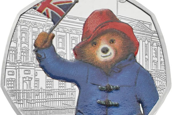 This coin shows the popular Peruvian bear outside Buckingham Palace waving a Union Jack on one side, while the other side depicts the queen (Photo: Royal Mint/PA Wire)