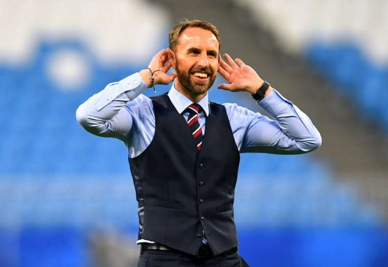 England manager Gareth Southgate - in his famous waistcoat - salutes the fans during the World Cup in Russia