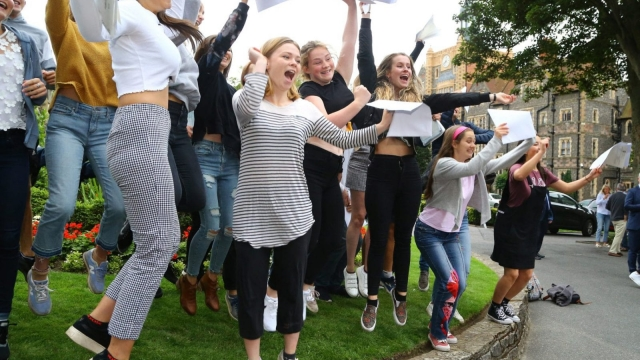 Students celebrate their A Level results at Brighton College in East Sussex (PA)