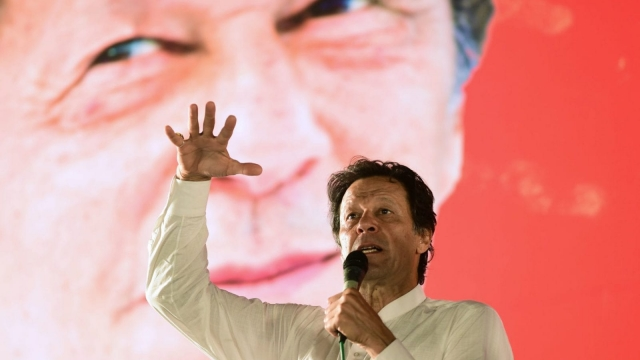 Pakistani cricket star-turned-politician and head of the Pakistan Tehreek-e-Insaf (PTI) Imran Khan addresses a political campaign rally ahead of the general election in Islamabad on July 21, 2018. Photo: Getty