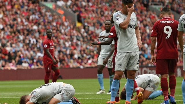 West Ham United's new signings suffered a 4-0 drubbing against a Liverpool side enjoying themselves in the Premier League opening weekend. (AFP/Getty Images)