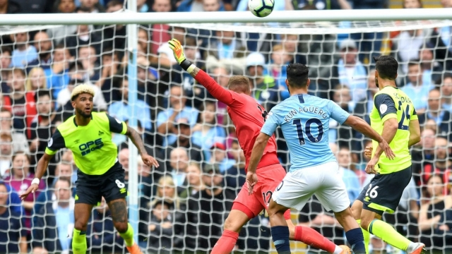 Sergio Aguero of Manchester City scores his team's first goal against Huddersfield Town on 19 August 2018. Some were convinced the goal was offside. (Getty Images)