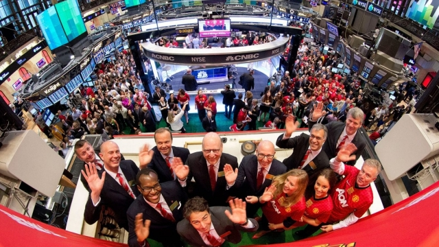 Manchester United executives prepare to ring the Opening Bell at the New York Stock Exchange in 2012 (Getty Images)