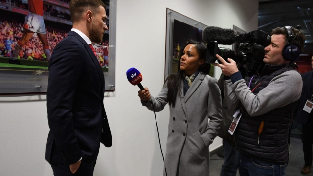Aaron Ramsey of Arsenal is interviewed by Alex Scott before the Premier League against Stoke City on 1 April 2018. (Arsenal FC via Getty Images)