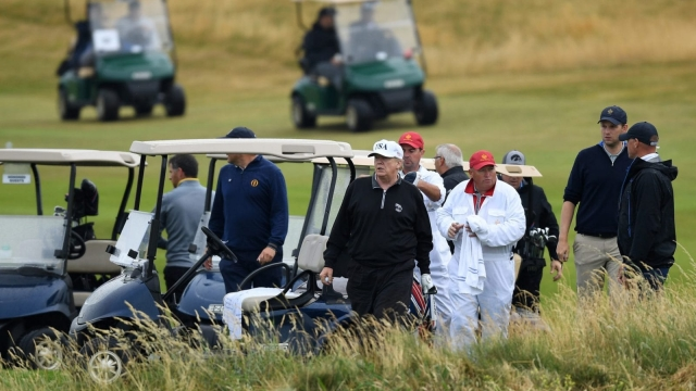 TURNBERRY, SCOTLAND - JULY 15: U.S. President Donald Trump plays a round of golf at Trump Turnberry Luxury Collection Resort during the U.S. President's first official visit to the United Kingdom on July 15, 2018 in Turnberry, Scotland. Trump's other golf course in Aberdeenshire sparked protests by conservation groups. (Photo by Leon Neal/Getty Images)
