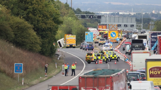 The scene on the the M25 exit slip road at Junction 3 at Swanley on the anti-clockwise carriageway after a coach overturned just before 4pm (Photo: Gareth Fuller/PA Wire)