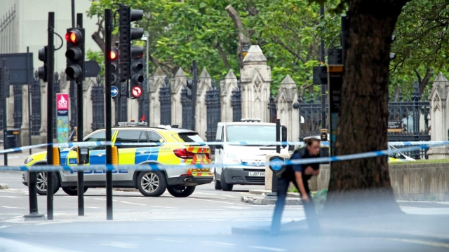 Police on Westminster Bridge, central London, after a car crashed into security barriers outside the Houses of Parliament (PA)