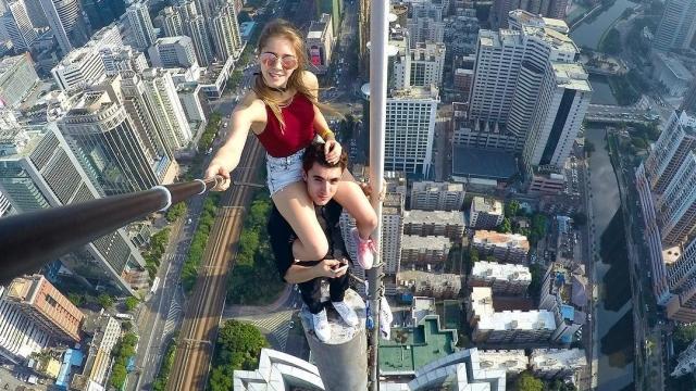 Russian Angela Nikolau, and boyfriend Ivan Beerkus, take selfies on top of some of the world's tallest buildings in a meme called roofing. Photo: Instagram