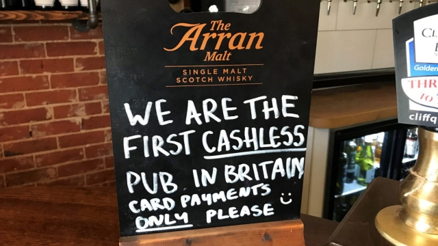 A sign on the bar of the Boot pub in Freston, near Ipswich, which claims to be the first cashless traditional pub in Britain (PA Wire)