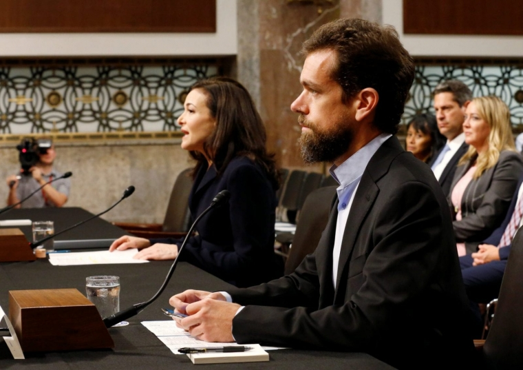 Twitter CEO Jack Dorsey and Facebook COO Sheryl Sandberg testify before a Senate Intelligence Committee hearing on foreign influence operations on social media platforms on Capitol Hill in Washington, U.S., September 5, 2018. REUTERS/Joshua Roberts