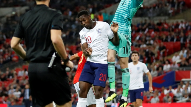 England's Danny Welbeck challenges Spain's David De Gea before scoring a goal which is subsequently disallowed (Action Images via Reuters)
