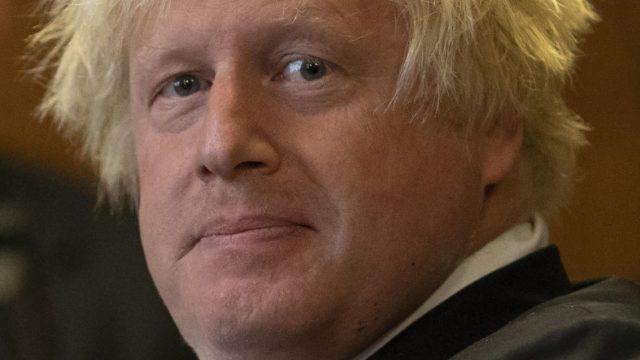 Boris Johnson listens on 11 September 2018 (Getty Images)