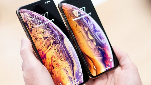 A person holds an Apple iPhone Xs Max (L) and iPhone Xs during a launch event on September 12, 2018, in Cupertino, California. - New iPhones set to be unveiled Wednesday offer Apple a chance for fresh momentum in a sputtering smartphone market as the California tech giant moves into new products and services to diversify.Apple was expected to introduce three new iPhone models at its media event at its Cupertino campus, notably seeking to strengthen its position in the premium smartphone market a year after launching its $1,000 iPhone X. (Photo by NOAH BERGER / AFP) (Photo credit should read NOAH BERGER/AFP/Getty Images)