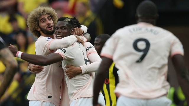 Marouane Fellaini celebrates with his Manchester United teammates (Getty Images)