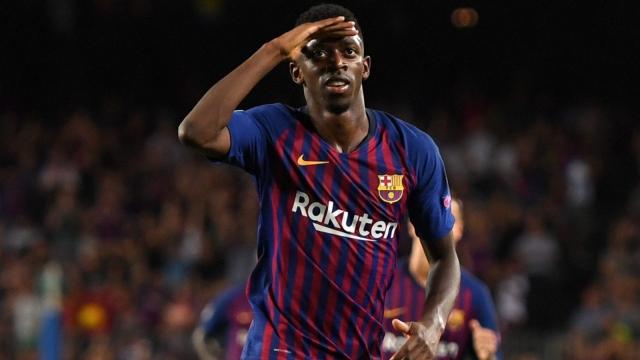 Ousmane Dembélé celebrates after scoring against PSV in the Champions League.