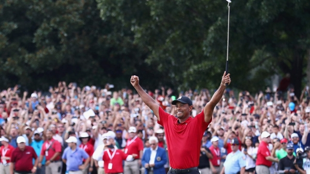 That winning feeling: Tiger Woods celebrates victory at the Tour Championship at East Lake Golf Club, his first win since 2013 (Getty Images)