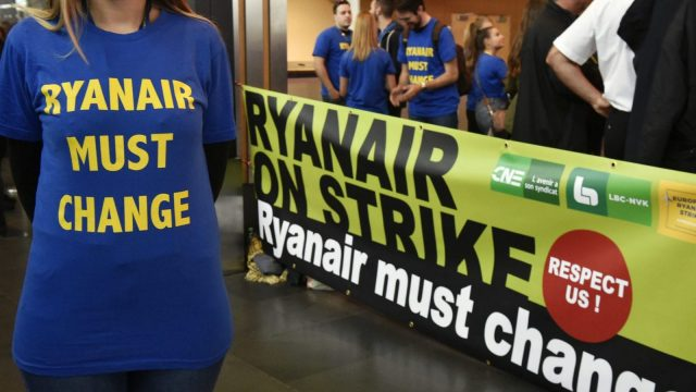 A Ryanair employee wearing a protest T-shirt during what could be the biggest strike in the airline's history, at Charleroi Airport, Belgium (Photo: John Thys/AFP/Getty Images)