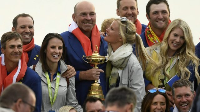 Article thumbnail: Europe's Danish captain Thomas Bjorn poses with the Ryder Cup trophy surrounded by team-mates and family (AFP/Getty Images)