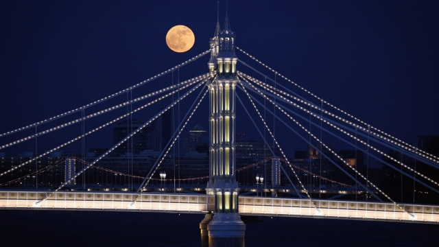 A full moon rises over Albert Bridge in London, England (Dan Kitwood/Getty Images)