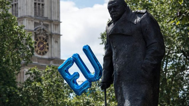 An EU balloon attached to the Winston Churchill statue in Parliament Square after a Brexit protest. (Photo: CHRIS J RATCLIFFE/AFP/Getty Images)