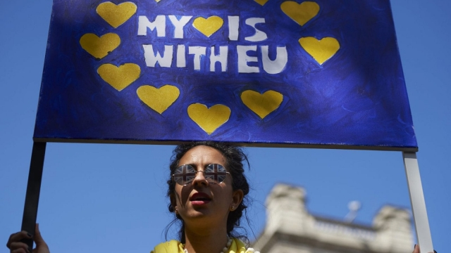 A woman holds up a pro-Europe banner in Parliament Square as thousands of protesters take part in a March for Europe, through the centre of London on July 2, 2016 (Getty Images)