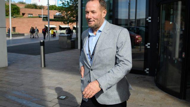 Former Labour politician Derek Hatton leaves a restaurant after meeting union leaders (Photo: Leon