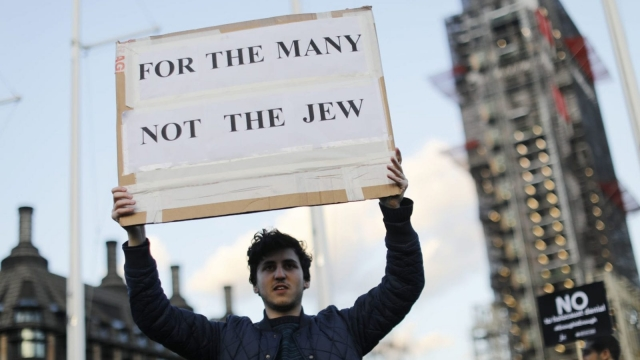 Members of the Jewish community hold a protest against Britain's opposition Labour party leader Jeremy Corbyn (TOLGA AKMEN/AFP/Getty Images)