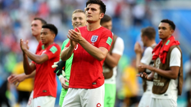 Article thumbnail: Harry Maguire applauds the fans after England lose their third-place World Cup match to Belgium (Getty Images)