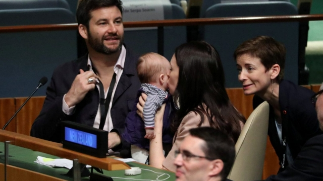 Jacinda Ardern kisses her baby Neve before speaking at the Nelson Mandela Peace Summit during the 73rd United Nations General Assembly in New York (Reuters)
