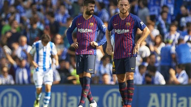 Gerard Pique (L) and Ivan Rakitic (R) during Barcelona's 2-1 win over Real Sociedad