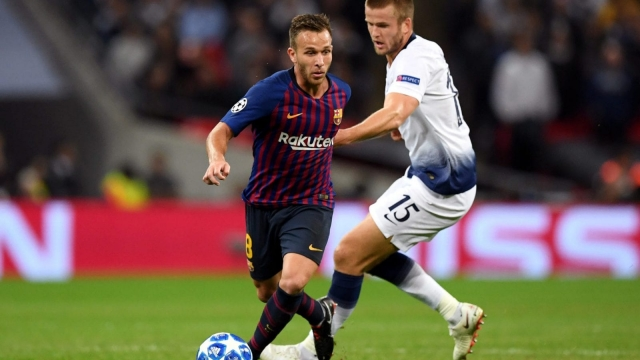 Barcelona midfielder Arthur wriggles away from Eric Dier at Wembley