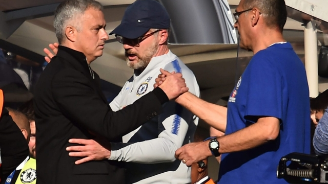 Jose Mourinho and Maurizio Sarri embraced at the end of a tempestuous game at Stamford Bridge (Getty Images)