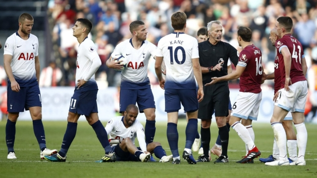 Article thumbnail: Lucas Moura tries to shake off a tough tackle from Robert Snodgrass (Getty Images)