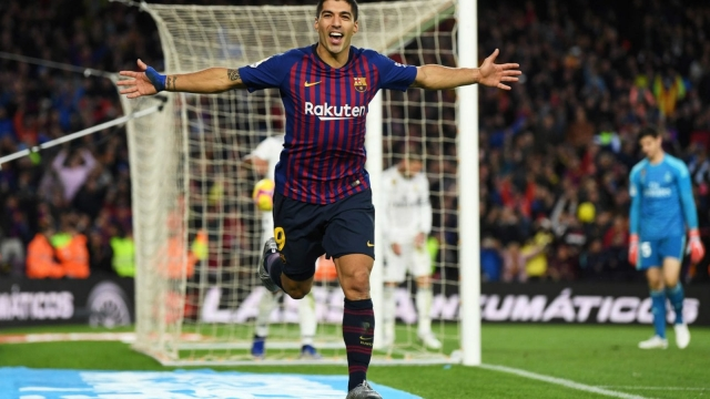 Luis Suarez celebrates finding the back of the net at Camp Nou