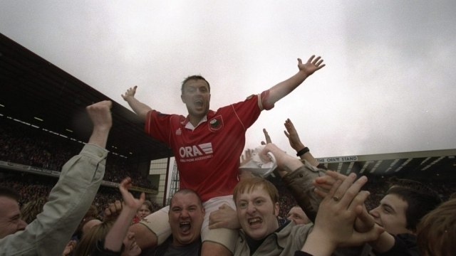 Neil Redfearn celebrates Barnsley's promotion in 1997 on the shoulders of fans at Oakwell (Getty Images)