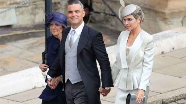 Robbie Williams and Ayda Field arrive for the wedding of Princess Eugenie to Jack Brooksbank at St George's Chapel in Windsor Castle (PA)
