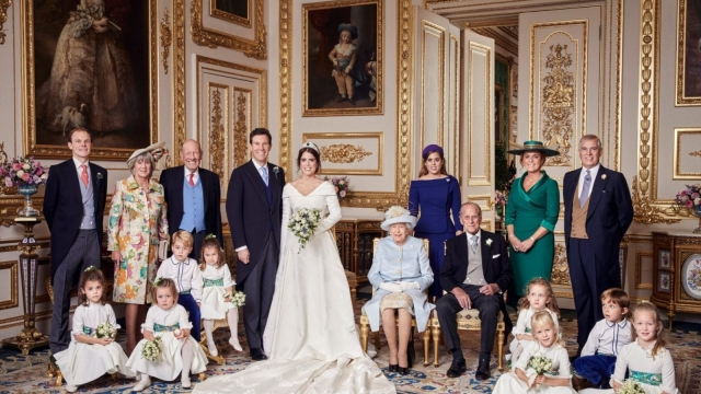 This official wedding photograph released by the Royal Communications shows Princess Eugenie and Jack Brooksbank in the White Drawing Room, Windsor Castle, Windsor, Britain, in this photo released October 13, 2018. With them are (L-R) Back row: Thomas Brooksbank, Nicola Brooksbank, George Brooksbank, Princess Beatrice, Sarah, Duchess of York, the Duke of York. Middle row: Prince George of Cambridge, Princess Charlotte of Cambridge, Queen Elizabeth, Prince Philip, Maud Windsor, Louis De Givenchy. Front row: Theodora Williams, Mia Tindall, Isla Phillips, Savannah Phillips. Alex Bramall/PA Wire/Handout via Reuters THIS IMAGE HAS BEEN SUPPLIED BY A THIRD PARTY. NO RESALES. NO ARCHIVES NEWS EDITORIAL USE ONLY. NO COMMERCIAL USE. NO MERCHANDISING, ADVERTISING, SOUVENIRS, MEMORABILIA or COLOURABLY SIMILAR. NOT FOR USE AFTER 30th April 2019 WITHOUT PRIOR PERMISSION FROM BUCKINGHAM PALACE. NO CROPPING. Copyright in the photograph is vested in Princess Eugenie of York and Mr Jack Brooksbank and Alex Bramall. Publications are asked to credit the photograph to Alex Bramall. No charge should be made for the supply, release or publication of the photograph. The photograph must not be digitally enhanced, manipulated or modified in any manner or form and must include all of the individuals in the photograph when published. PRESS ASSOCIATION Photo. Issue date: Saturday October 13, 2018. See PA story ROYAL Wedding. Photo credit should read: Alex Bramall/PA Wire NOTE TO EDITORS: This handout photo may only be used in for editorial reporting purposes for the contemporaneous illustration of events, things or the people in the image or facts mentioned in the caption. Reuse of the picture may require further permission from the copyright holder.