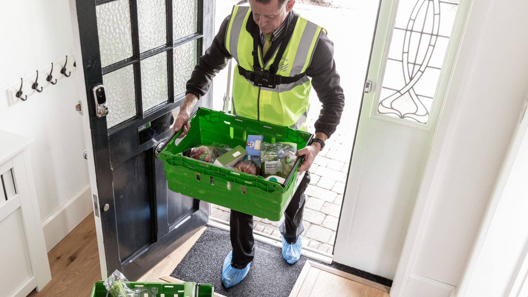 Waitrose's While You're Away service allows delivery drivers to enter customer's homes to unpack their shopping (Photo: Waitrose)