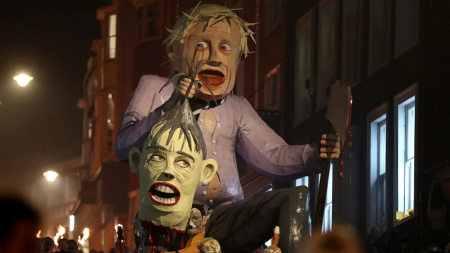 An effigy of Boris Johnson is paraded through the town of Lewes in East Sussex during an annual bonfire night procession held by the Lewes Bonfire Societies. Gareth Fuller/PA Wire