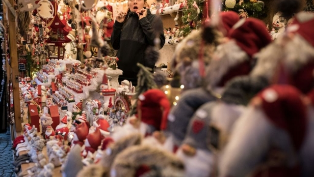 Festive Christmas decorations are displayed for sale on a stall in Manchester Christmas Market (Getty)