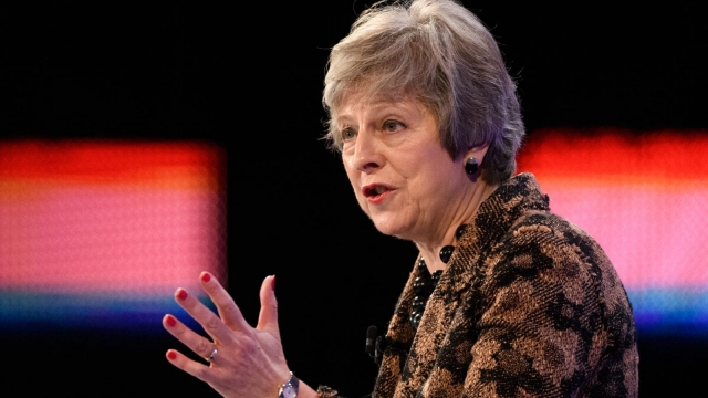 Prime minister Theresa May said EU nationals would no longer be able to jump the queue 'ahead of engineers from Sydney or software developers from Delhi', at the CBI Conference on November 19 (Photo by Leon Neal/Getty Images).