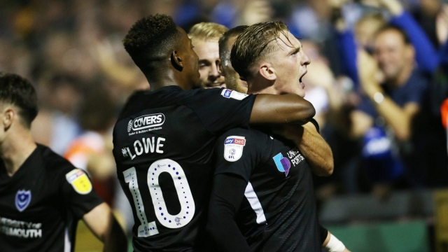 Ronan Curtis and Jamal Lowe celebrate the former's winner against Bristol Rovers (Photo via Portsmouth FC)