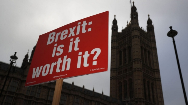 A pro-EU demonstrator holds up a placard outside the Houses of Parliament as Britain's Prime Minister Theresa May gives a statement on the draft Brexit deal in London on 15 November (Photo: AFP/Getty)