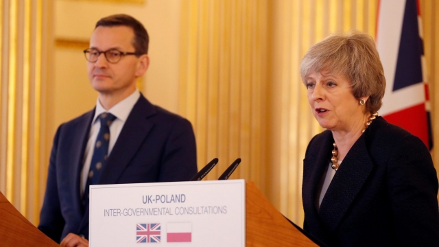 Britain's Prime Minister Theresa May (R) and Poland's Prime Minister Mateusz Morawiecki attend a joint press conference during the UK-Poland Inter-Governmental Consultations at Lancaster House in central London on December 20, 2018. (Photo by Alastair Grant / POOL / AFP) (Photo credit should read ALASTAIR GRANT/AFP/Getty Images)