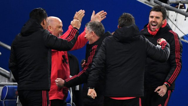 Solskjaer celebrates with his backroom staff on the touchline