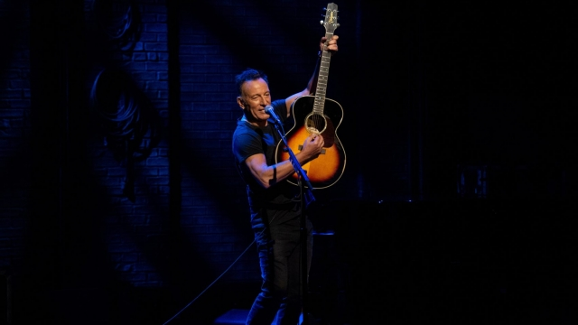Bruce Springsteen talks about how he came to write 'Born In The USA' and considers the motivations behind other songs in 'Springsteen on Broadway' (Photo: Netflix)