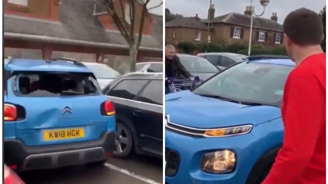 Shopping trolleys were rammed into the side of the car (Photo: Twitter)