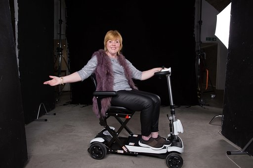 Hayley uses her scooter to get to and from her local gym for low impact aerobics classes. (Photo: Louis Browne/MS Society)