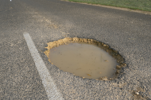 More than 512,000 potholes were reported to authorities last year (Photo: Shutterstock)